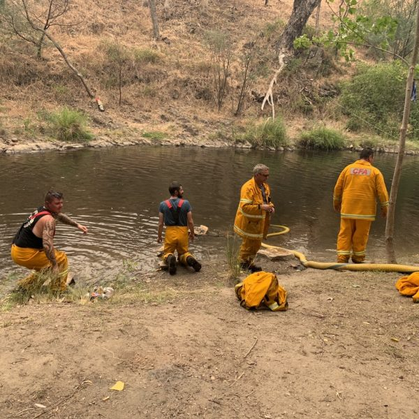 Volunteers taking a refreshing wash in Nariel Creek after a hectic night of fire fighting and asset protection, 17 hours after the initial turnout to the Green Gully Fire jumping the Murray River from NSW on December 30th 2019.