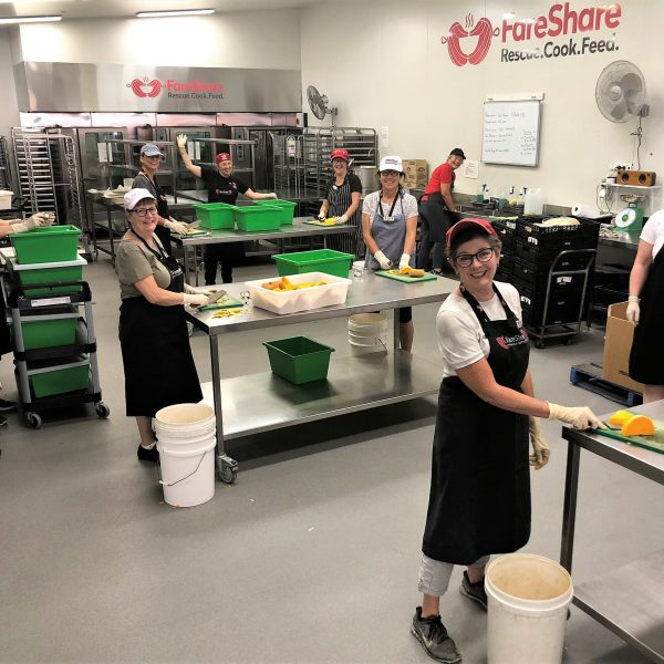 Volunteers safely social distancing in the pastry kitchen