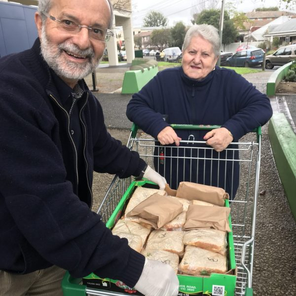Dr Gershon Zuker is delivering sandwiches, fritatas , compote and fruit to Golden Age Club members at St. Kilda, as he does every Tuesday.